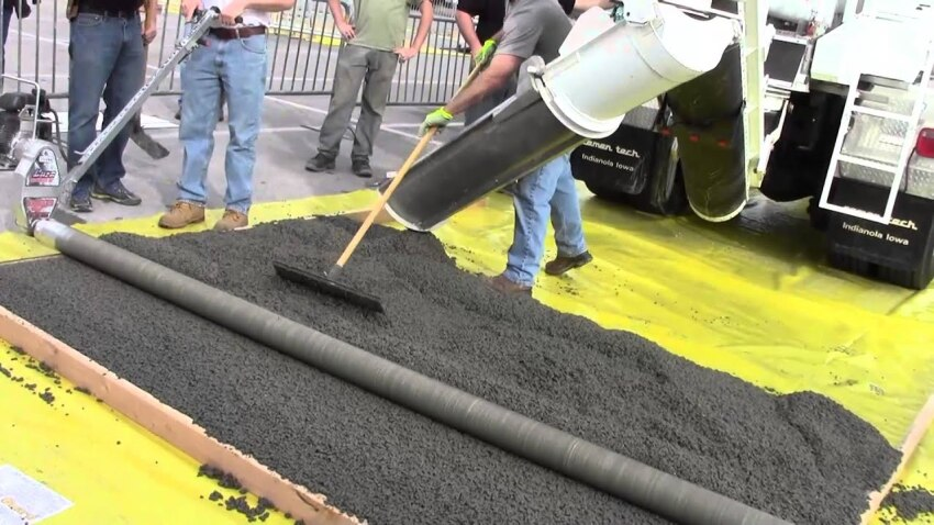 2014 WOC Attendees learned on how use a roller screed on fresh concrete