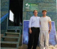 Matt Petersen, president and chief executive officer of Global Green USA, stands with Brad Pitt outside an environmentally friendly home being built in New Orleans' Ninth Ward.