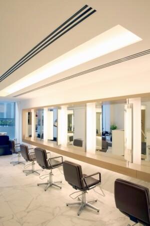 'An elongated light coffer creates an illuminated slot delivering plenty of light to a defined area: soft, glare free task lighting.'John Freida Salon, Mayfair, London