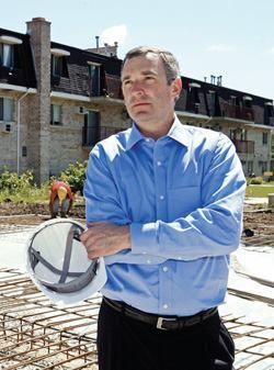 Dave Woodward checks on the renovation status of The Mont Clare Apartments in Chicago.
