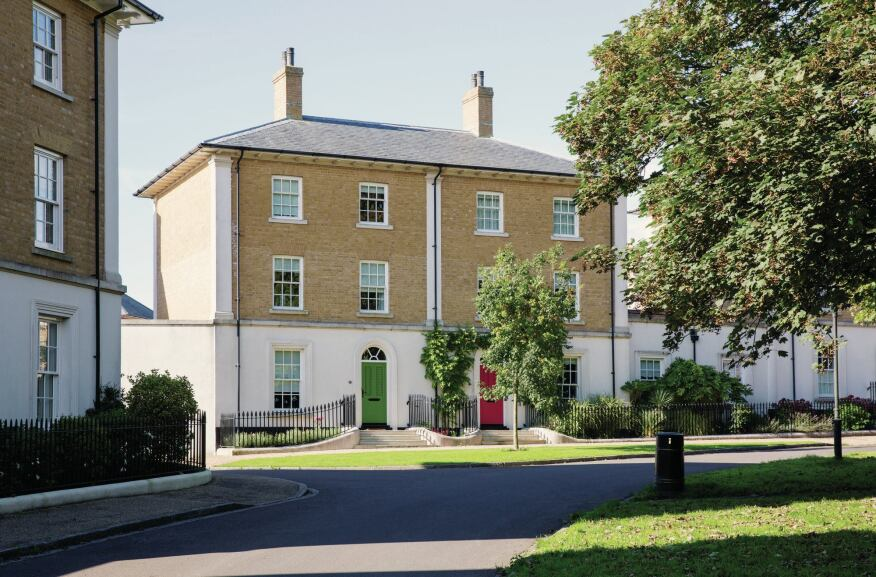 These upscale Georgian revival terrace houses in Woodlands Crescent in Poundbury were designed by Ben Pentreath and strike a good architectural balance, just hinting at their 18th-century influences.