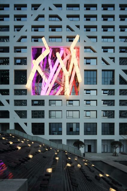 An installation designed by Lebbeus Woods is integrated into the tower facade.
