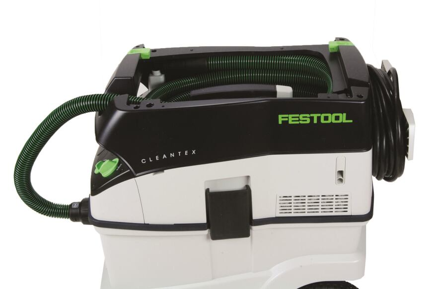 "Hose garage. Dubbed a ""hose garage,"" the sculpted contours of the Festool unit's top provided the most effective way to store the vacuum hose."