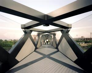 The new Weave Bridge at the University of Pennsylvania creates a pedestrian passage over the Amtrak train tracks that currently separate the main campus from athletic fields along the Schuylkill River.