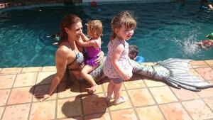 A professional mermaid entertains children at a birthday party in the San Fernando Valley. Iridescence: A Mermaid Tribe does more than 20 events a year.