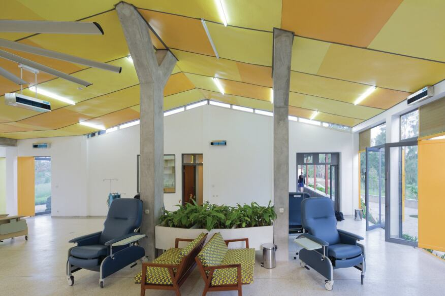 Infusion room, with a view to the outdoor colonnade and the offices and private consultation rooms.