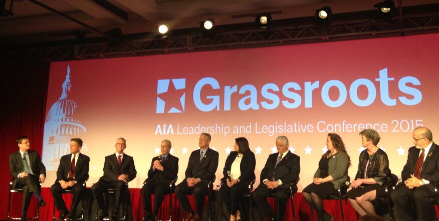 Ned Cramer (far left) moderates a panel of nine candidates running for AIA positions.