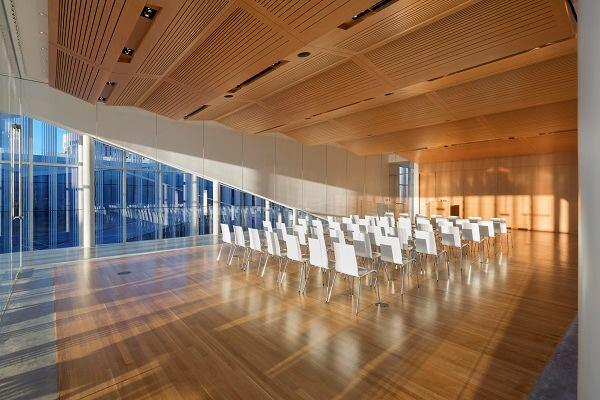 The cantilevered forum volume in lined inside with warm wood and can be used for lectures and events.