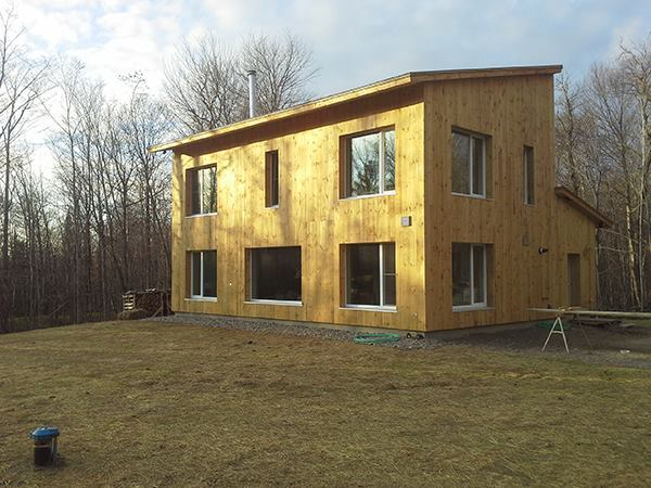 Chris Pike's house, built by Alex Carver (Northern Timbers Construction), near completion in fall 2013. This winter, says Pike, the house stays comfortable in below-zero weather with one or two firings of the wood stove per day.