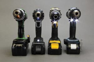 Every drill in the test has an LED headlight. From left: The heavy-duty Hitachi's light is built into the belt hook and must be manually activated. Panasonic's is in the base and is also manually activated. The lights in the other models — including the DeWalt DCD980L2, shown — are activated by the trigger and are located in the base or above the trigger. The Makita BDF451 has a pair of lights above the trigger.