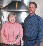 Homeowner Kathy Townsend stands with lead carpenter Art Tompkins in her new kitchen. Tompkins has worked on six projects for Townsend in the past four years.
