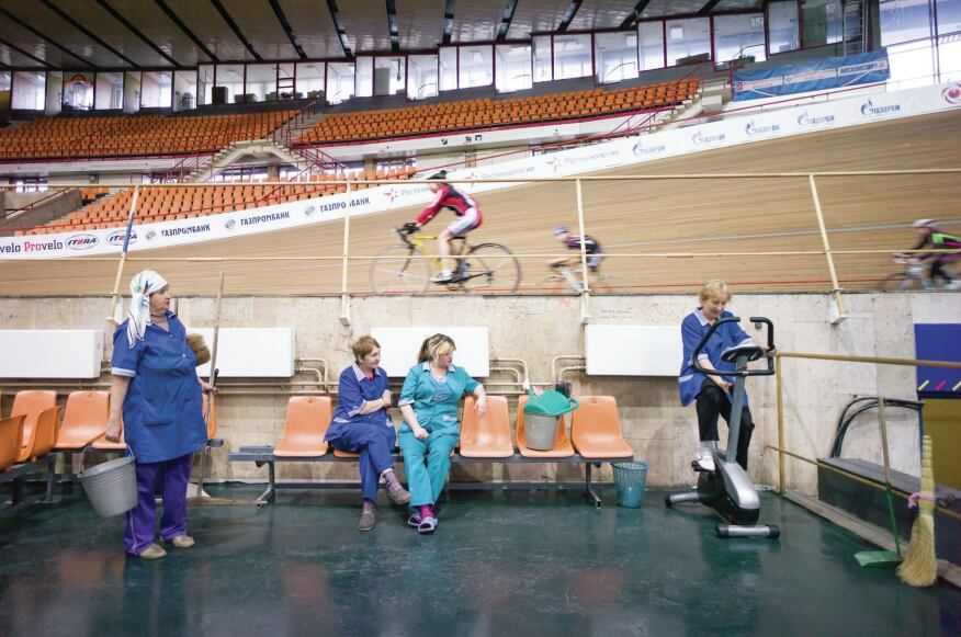 Moscow 1980   Cleaning women take a break at the Krylatskoye Sports Complex Velodrome, which hosted the track cycling events at the 1980 Games. Designed by the Moscow Research and Design Institute for Culture, Recreation, Sports, and Health Facilities, the velodrome features a 333.3-meter track made of Siberian larch that ranks among the world's fastest surfaces. (Its 42-degree banked turns also rank among the world's steepest.) The facility regularly hosts international races, including the Moscow Grand Prix.