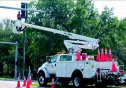 "Crews perform preventive maintenance at an intersection in Hernando County. The  county received the National Association of Counties 2003 Achievement Award  for its program ""Applying Best Management Practices with In-House  Designed Maintenance Management System."" Photos: Harry Lorick"