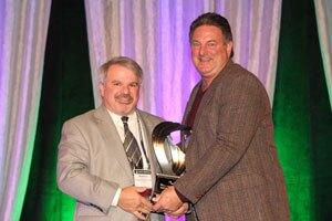 Dominic Girotti (left), the 2014 Robert E. Yoakum Award winner, presented the 2015 award to Chuck Babbert, president of sales at E.C. Babbert Inc.