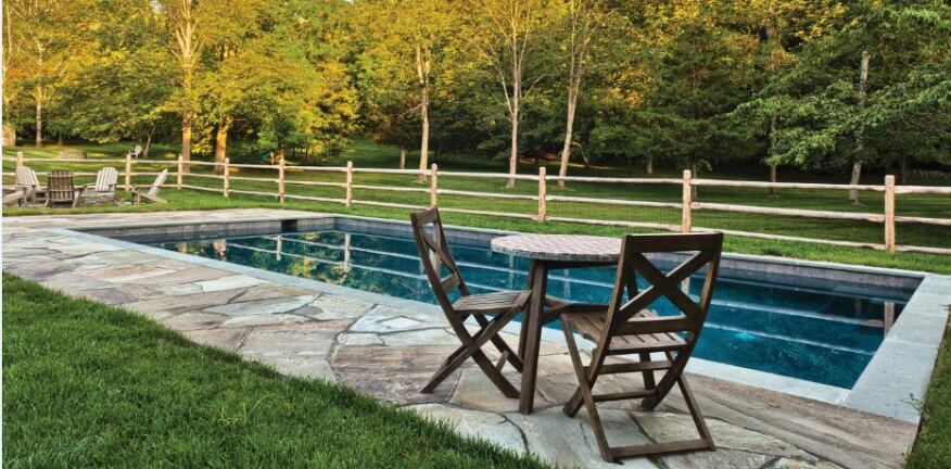 Kris Schmitt of Neave Pools in Wappingers Falls, N.Y., designed this pool with split railings to reflect the community's horse-keeping heritage. A mesh screen between the rails makes it code compliant.