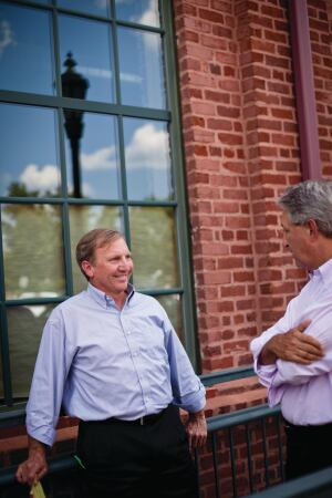 Alan Simonini talks with his business partner Ray Killian near their offices in Charlotte, NC.
