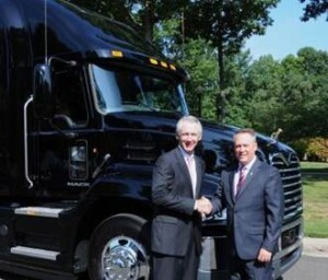 Gov. Bill Graves (left), president and CEO of the American Trucking Associations, accepts a 2014 Mack® Pinnacle model from Stephen Roy (right), president of Mack Trucks North American Sales and Marketing, for use in the Share the Road highway safety education program.