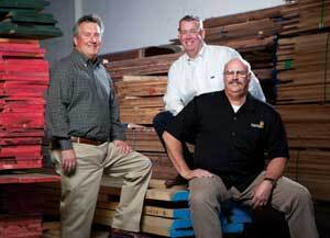 THEY KNOW WOOD: Southern California's Ganahl Lumber draws remodelers and builders in part because of the quality of the wood it sells. Helping engineer those sales are Tom Barclay (left), general manager of the Los Alamitos yard; Pete Ganahl (center), a top outside sales rep based in Los Alamitos; and Bill Shaw (right), general manager of the Lake Forest store.