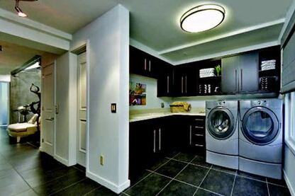 In the back of the plan is a mudroom (above) that enables the occupants to unload groceries brought in from the detached garage, which is separated from the house by a trellised pool area and garden (below), before taking the elevator to the third-level kitchen.