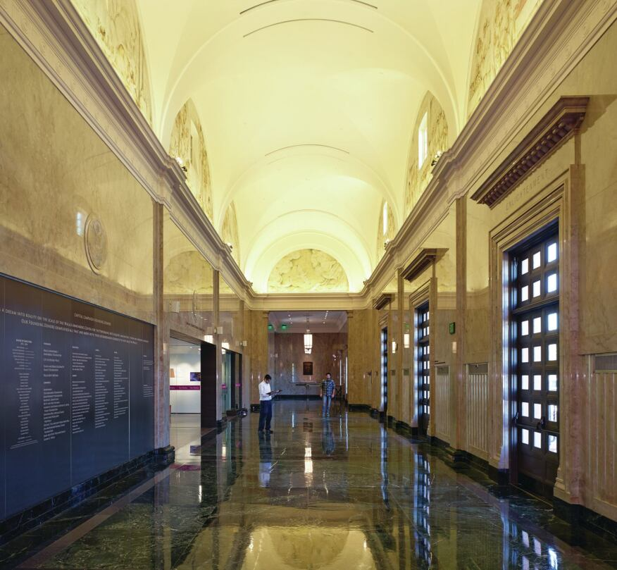 The vaulted post office lobby boasts restored frescoes by WPA artist Charles Kassler.