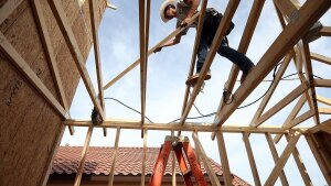 FILE - JUNE 24: According to reports June 24, 2014, new home sales surged in May by 18.6 percent, the largest one month gain since 1992. PHOENIX, AZ - MARCH 05:  A worker builds a new home at the Pulte Homes Fireside at Norterra-Skyline housing development on March 5, 2013 in Phoenix, Arizona. In 2008, Phoenix, Arizona was at the forefront of the U.S. housing crisis with home prices falling 55 percent between 2005 and 2011 leaving many developers to abandon development projects. Phoenix is now undergoing a housing boom as sale prices have surged 22.9 percent, the highest price increase in the nation, and homebuilders are scrambling to buy up land.  (Photo by Justin Sullivan/Getty Images)