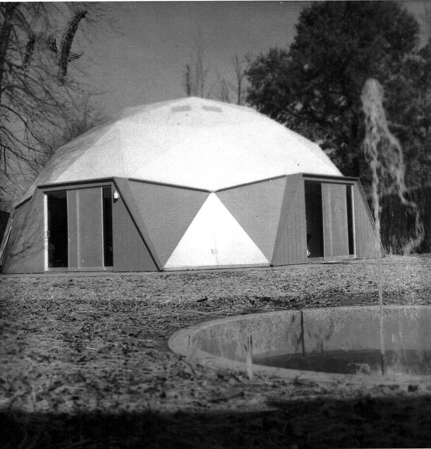 The grounds included a fountain and a privacy fence (circa 1960).