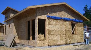 The exterior of a Lopez Island house shows the straw bale construction.
