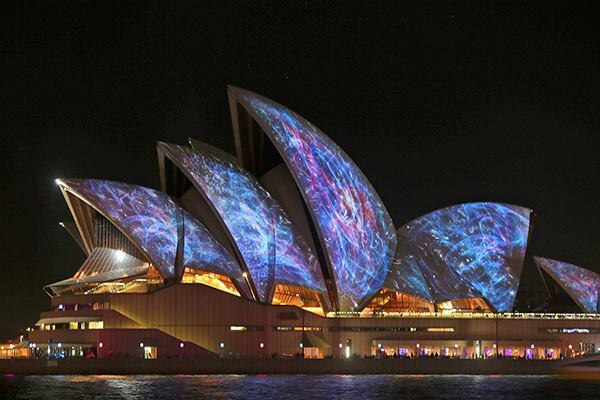 The Sydney Opera House, designed by Jørn Utzon, is lit up for the Vivid Sydney festival on May 23.