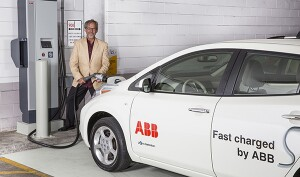 Ken Graber, director of media relations at ABB, charges the company's Nissan LEAF at the UWM quick-charge station in the Klotsche Center & Pavilion parking structure.