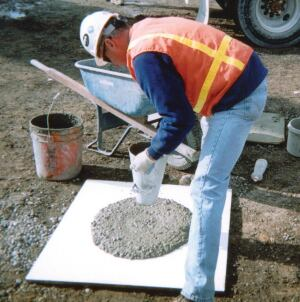 "An SCC ""slump"" test, often performed with the slump cone upside down, measures the diameter of the spread of the concrete."