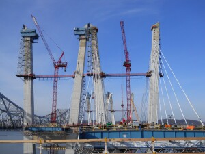 Main span towers reached their full 419-foot heights in December 2016. You can see the structural steel blue girders that will be covered with road deck panels. Main span and approach span were not connected in this picture.