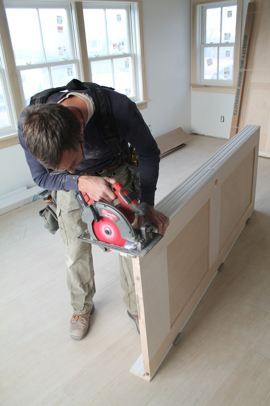 After cutting the first edge, flip the door over and repeat the process with the other jamb leg. Be sure the hinge screws aren't coming through the jamb on the other side—they can ruin a finished floor quickly!