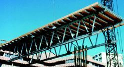 Flying forms for slabs are the horizontal equivalent of gang forms for walls. Also known as table forms, these large, truss-mounted assemblies are moved upward from floor to floor by crane.