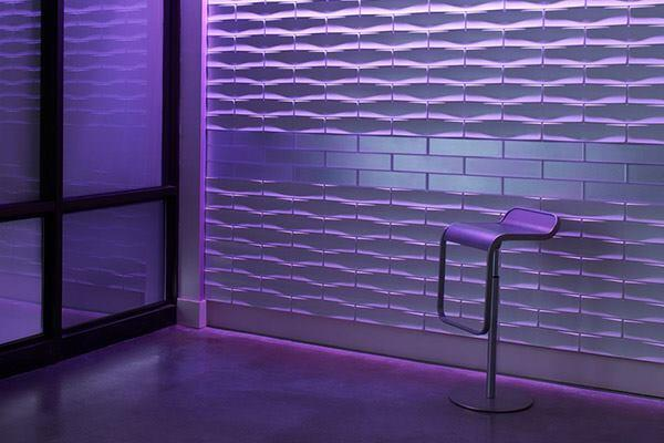 """Wall planes become three-dimensional with Profile, a modular surface system from 3form. The system of 4'-by-8' panels or 4""""-by-15 ½"""" tiles has four geometrical contours and 18 finishes to choose from. They can also be painted on site. The panels can be edge-matched horizontally and vertically, while the tiles can be integrated with the company's Chroma tiles. 3-form.com"""