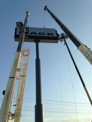 Workers install the new Mack pylon sign at Valley Truck Centers in Cotulla, Texas. The sign is the world's largest Mack dealership sign.