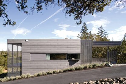 Strong geometrical forms and soft, muted colors give this new house an assertive yet respectful presence in its rural landscape.
