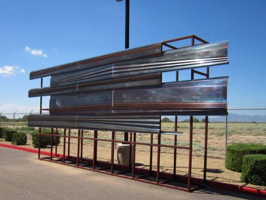 This is the third and final mock-up by Kovach Building Enclosures. In the previous iteration, Kovach presented a roll-formed panel design, but the straight lines looked too uniform. Kovach and CO Architects resolved the issue by angling some pleats across the panel faces, which meant each panel had to be bent individually in a press brake (a punch-and-die machine tool) at the Kovach plant 20 miles away in Chandler, Ariz. It took Kovach nine months to fabricate nearly 6,000 panels along with copper sunscreens, fins, and other finish pieces. Kovach delivered panels as they were made, allowing an on-site crew to install them. The process took seven months.