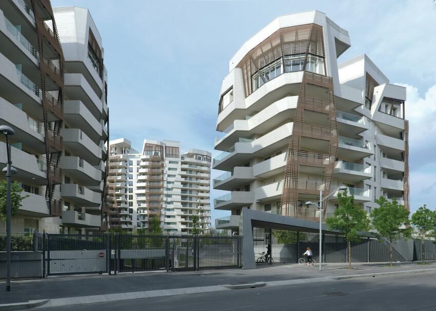 The Libeskind residences are clad in tile and wood-composite lattices and topped by penthouse duplexes.