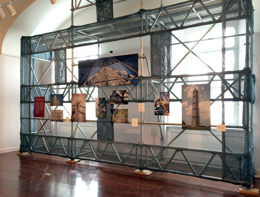 A small piece of the scaffolding and scrim used in the Washington Monument repairs is installed at the exhibition.