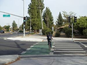 Cyclists and pedestrians use separate crossways in protected intersections such as this one in Davis, Calif. The city's initial plan was to separate traffic with multimillion-dollar grade-separated crossings for bicycles and pedestrians. But when the city council reviewed the proposal in April 2014, council member Brett Lee offered a different idea. An engineer and avid cyclist, he advocated for a protected intersection design he'd encountered when cycling in the Netherlands.