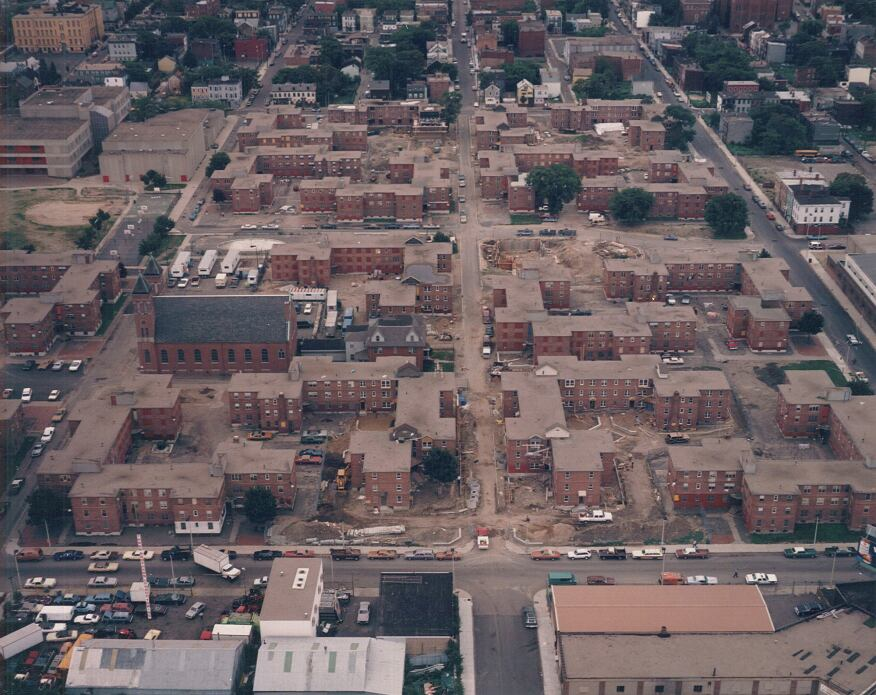 An aerial view showing the complex as it stood before renovations, with the remains of the 1948 public housing development.