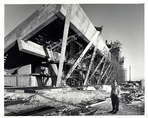 Architect Hilario Candela stands in front of the stadium during construction in 1963. This December marks the 50th anniversary of its opening.