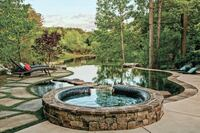 A Softly Curved Pool in Georgia Appears to Flow Into Lake