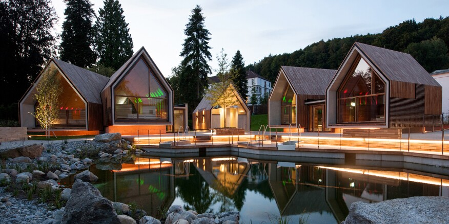Parkhotel Jordanbad's sauna village includes (l to r): the infusion sauna, a shower facility, the fireplace sauna, and the herbal sauna.