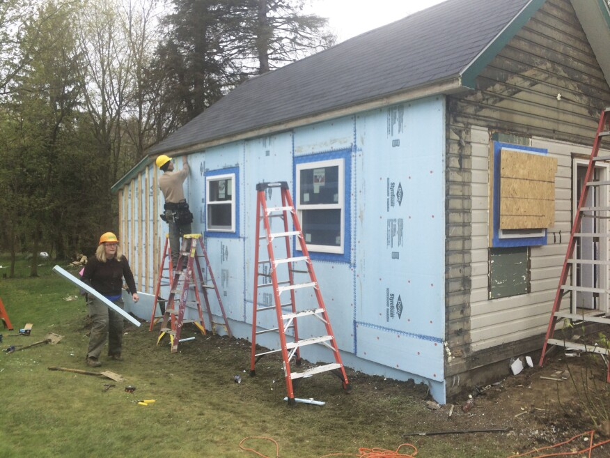 Volunteers added donated rigid XPS insulation sheets to the exterior to augment the R-value of the wall system.