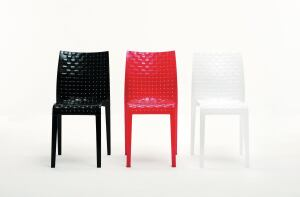 "Ami Ami from Kartell is a table and chair created by Japanese designer Tokujin Yoshioka. Meant to recall traditional Japanese interlaced patterns, Ami Ami creates an optical illusion that mimics the warp and weft of fabric. The line is available in clear or smoked transparent versions, as well as in a series of glossy saturated colors including black, white, and red. The chair is stackable and made out of polycarbonate, and the table has a 27-1/2""-square polycarbonate top with aluminum legs. The chair is 16"" wide, 33"" tall, and 19-1/2"" deep. kartell.com"