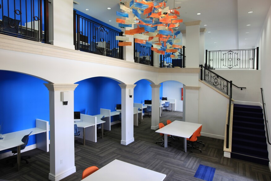 Lorenzo's study areas feature brightly colored walls and furnishings and desks reminiscent of library carrels.