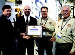 Far left, Don Hinshaw and Steve Chamberlain receive the Vendor of the Year Award for 2005 from Hub Construction Specialties at the 2006 World of Concrete.