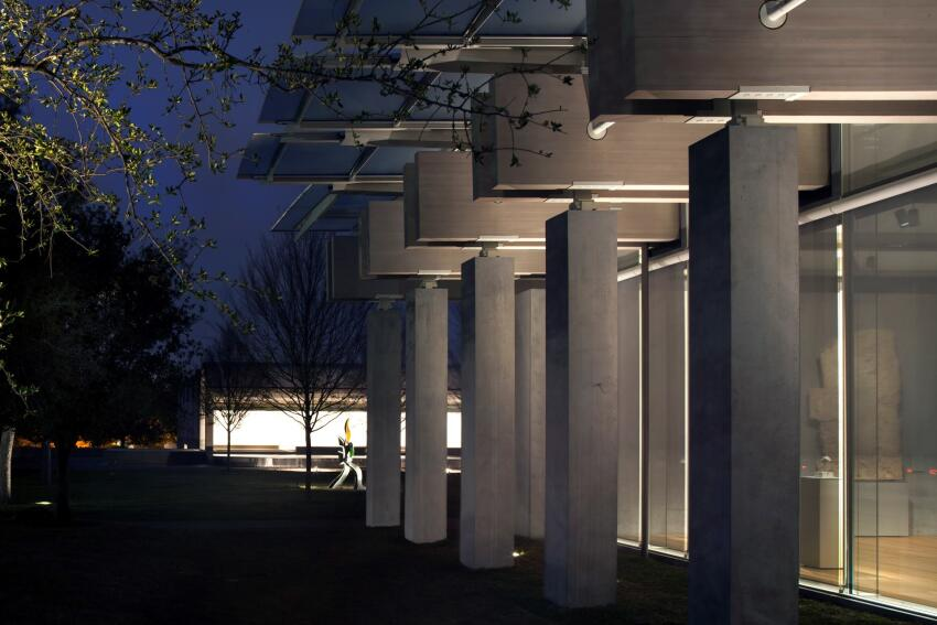 North façades of the Renzo Piano Pavilion and original Kahn building, view at night.
