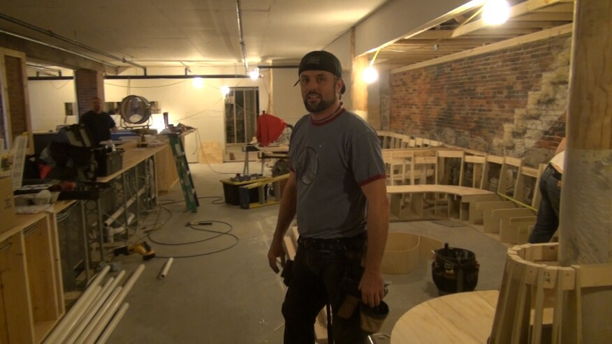 Nat Towl in the basement space under construction at 4 Free Street in Portland, Maine. To Towl's left will be 70 linear feet of lounge seating, with additional easy chairs and tables. To his right, the rough structure of a 40-seat Tiki bar is taking shape.